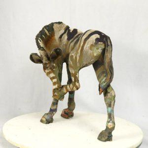 Scratching zebra